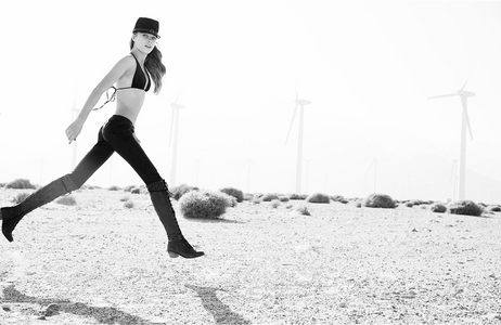 Girl in Palm Springs Jumping with Windmills