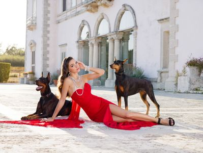Florida Castle Girl with Dobermans