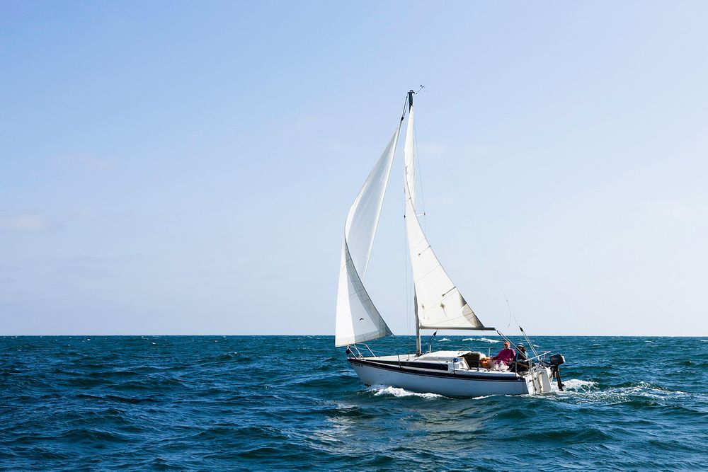 Sailboat in Blue Ocean