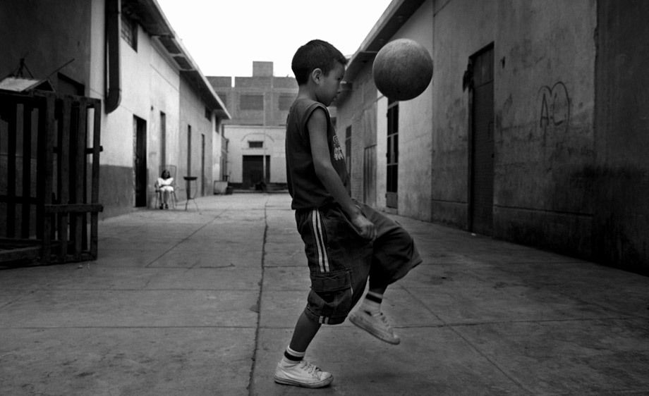 YOUNG BOY AND SOCCER BALL