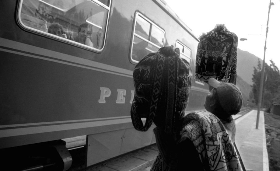 ANDES WOMAN AND TRAIN PASSENGERS
