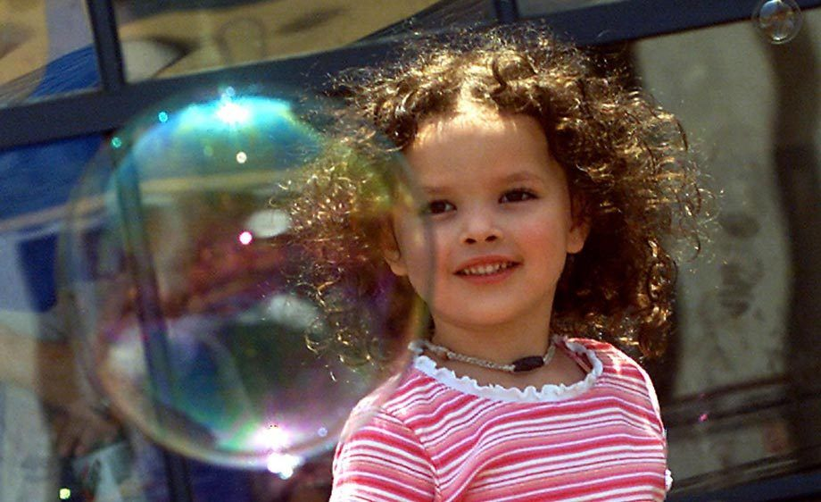 GIRL AND SOAP BUBBLE