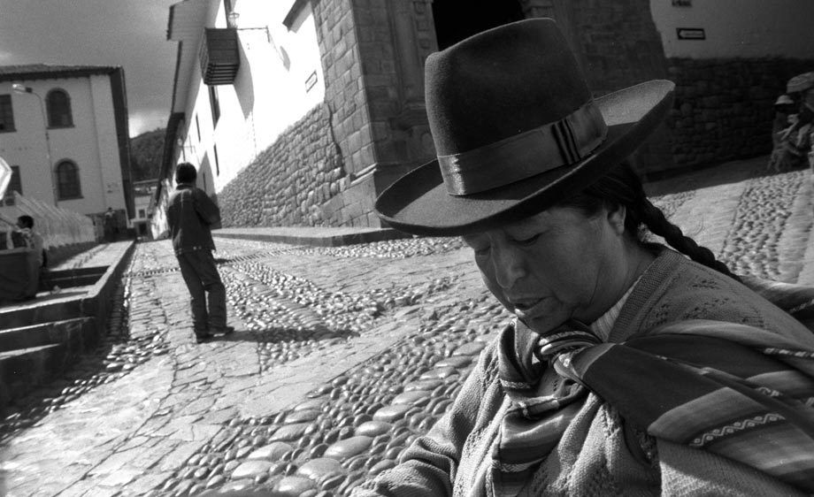 ANDES WOMAN AND COBBLESTONE STREET