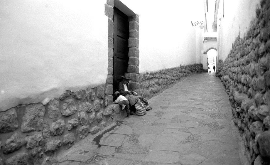 ANDES WOMAN AND CUSCO STREET