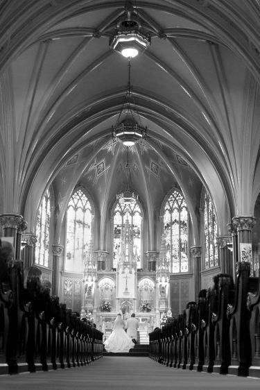 1couple_at_altar_from_back_of_church.jpg