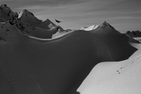 Snowboarder catches massive air in Austria