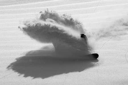 Snowboarder Slashes in Pristine Powder