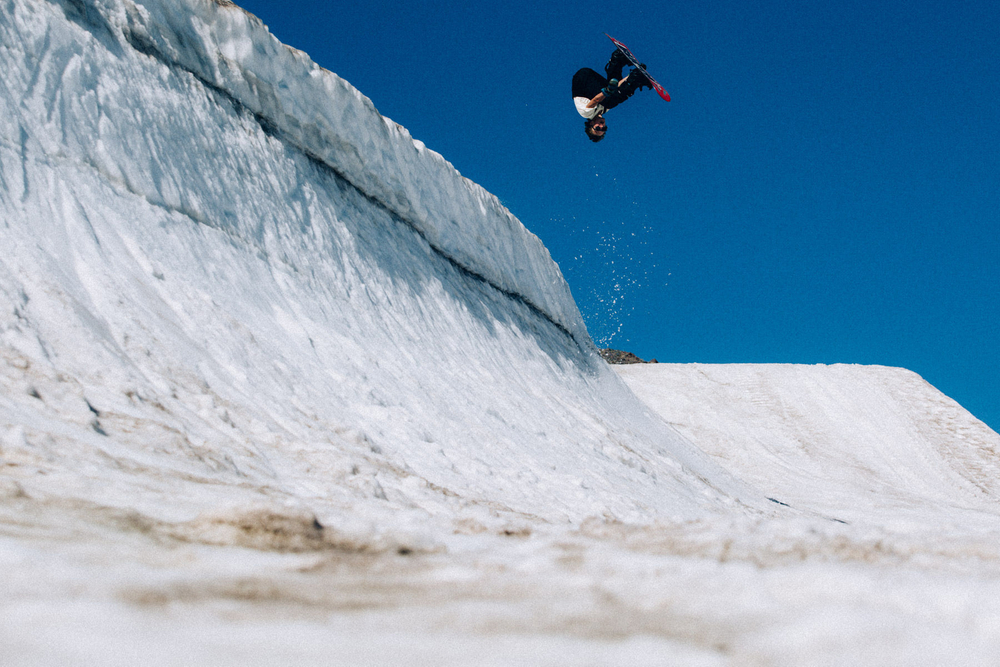 Red Gerard flipping upside-down on a quarter pipe