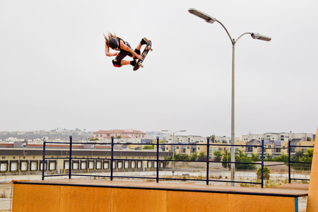 Shaun White flies above a ramp on his skateboard