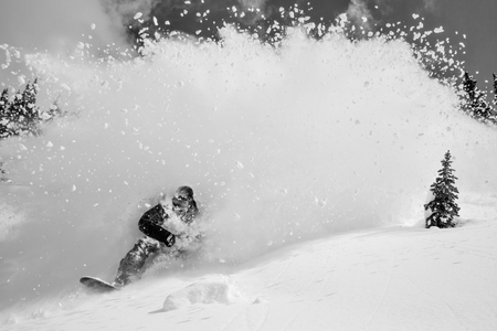 Snowboarder Flys Out of an Explosion of Powder