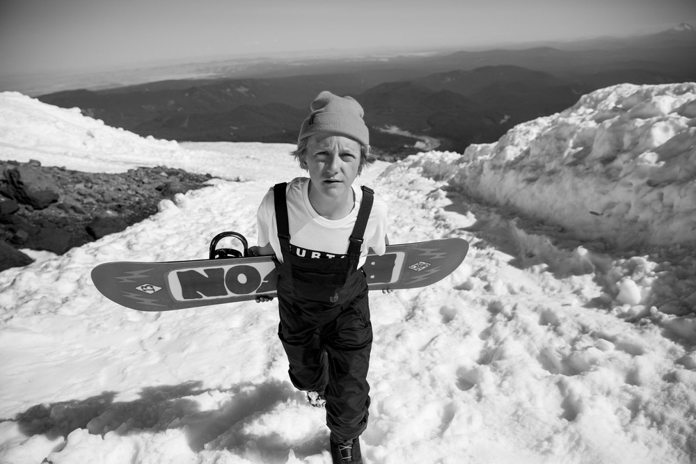 Red Gerard hiking up a mountain