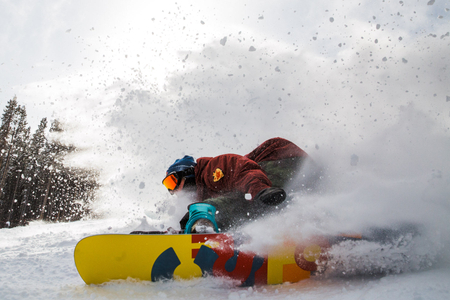 Snowboard does a high speed carve