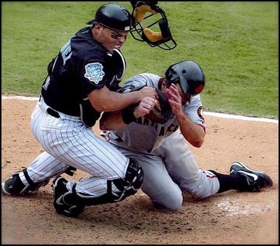 Florida Marlins Pudge Rodriguez tags out San Francisco Giants' J.T. Snow