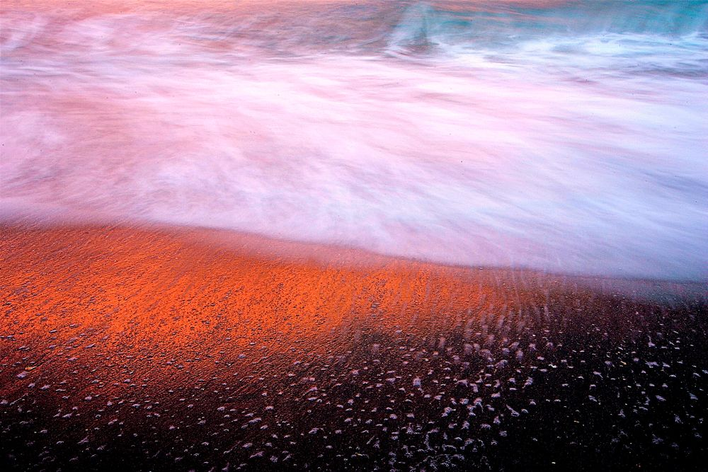 OCEAN at Sunrise: red sand.