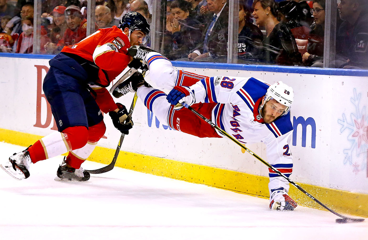 Diving for the puck.