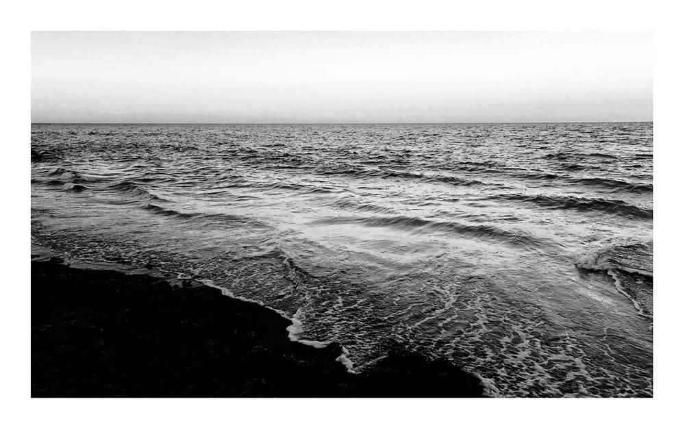 Tide rolls over shoreline.