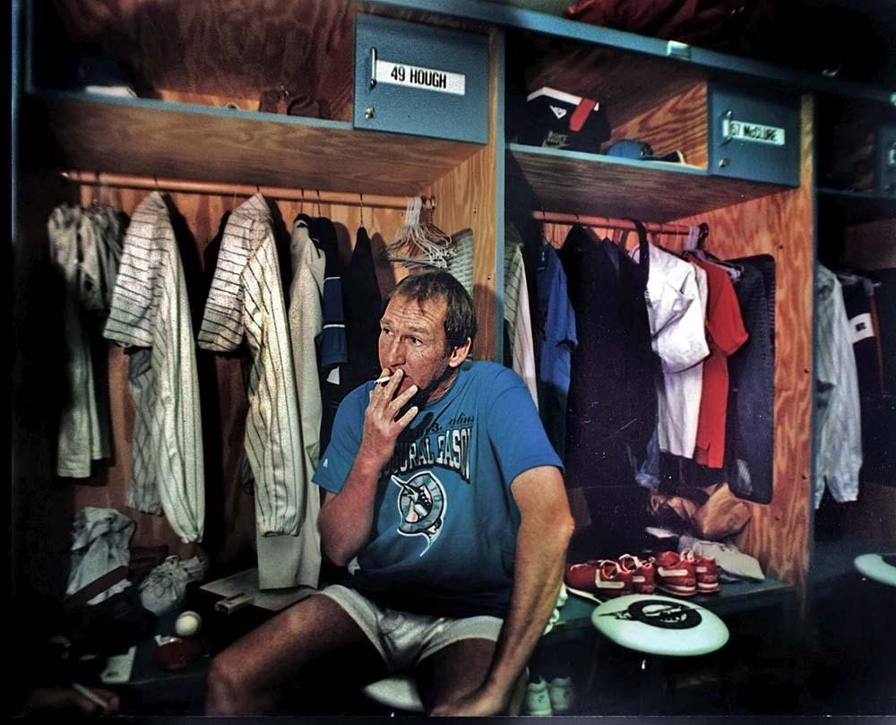 Florida Marlins pitcher Charle Hough, smokes a cigarette  during spring training.