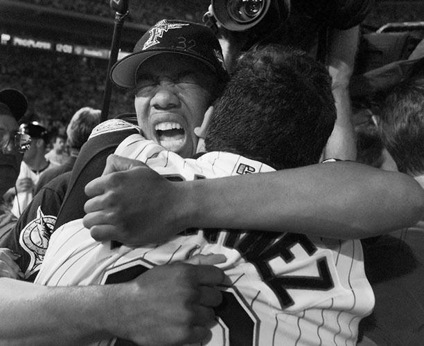 Florida Marlins 1997 World Series MVP, Livan Hernandez, celebrates with Alex Fernandez .