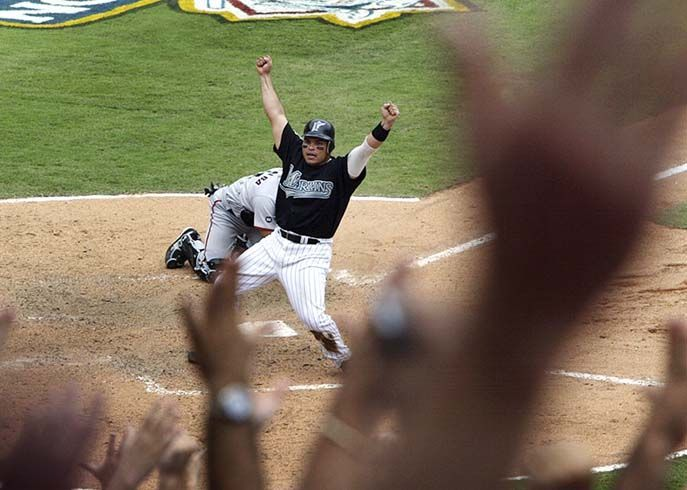 Pudge Rodriguez  celebrates his  winning run  in the 2003 NLDS.