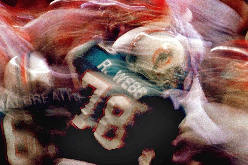 Long exposure image of  Dolphins tackle, Richmond Webb.