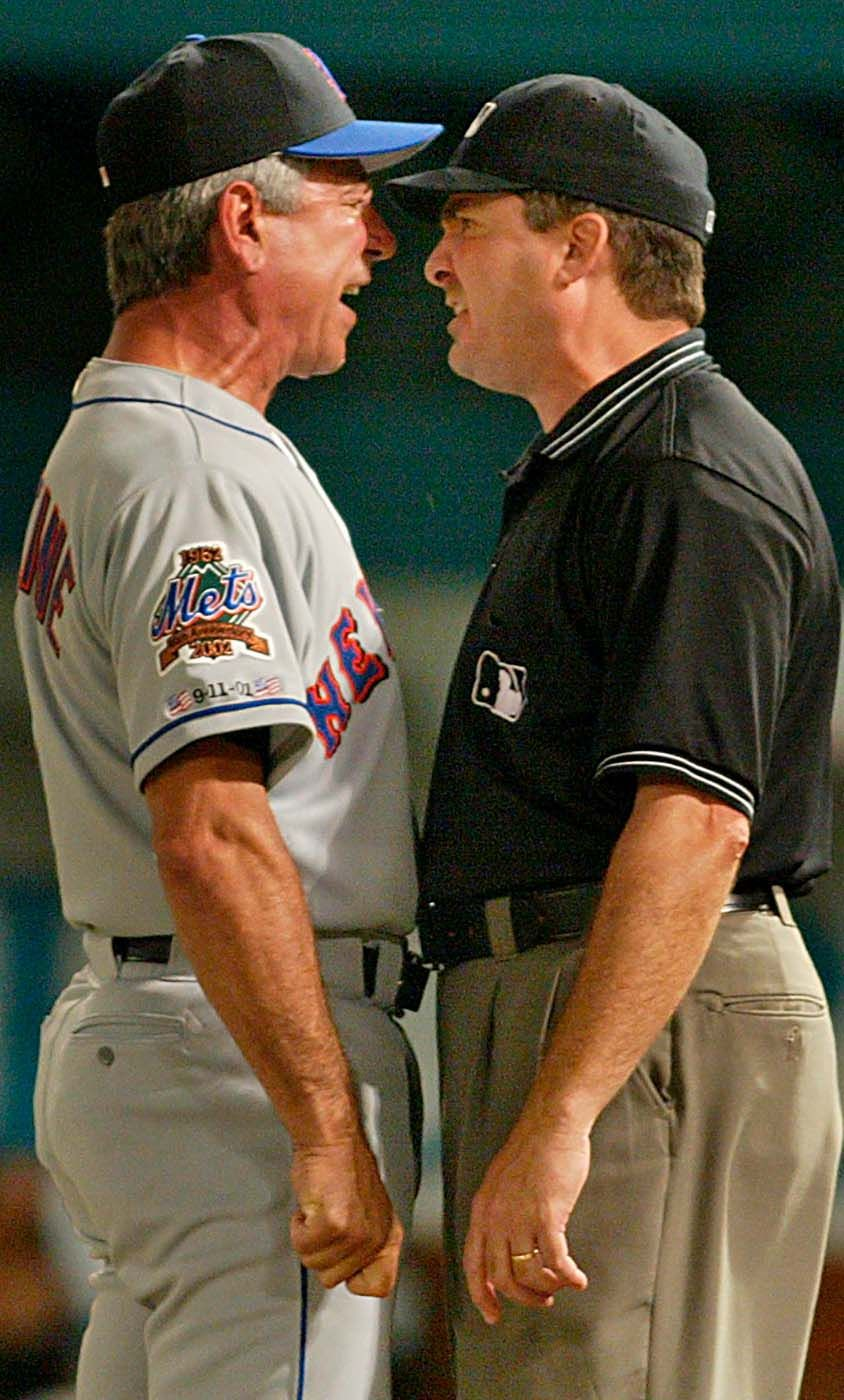 Manager Bobby Valentine goes nose to nose with Umpire  Mark Wegner ,