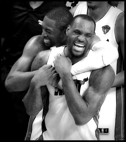 Dwyane Wade and LeBron James celebrate their NBA championship.