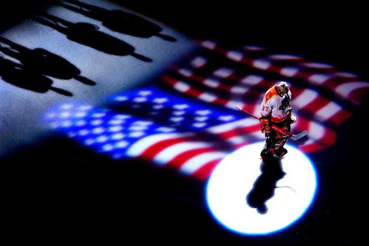 Florida Panthers goalie Trevor Kidd stands in the spotlight during the national anthem.