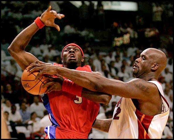 Shaquille O'Neal strips Ben Wallace of the ball