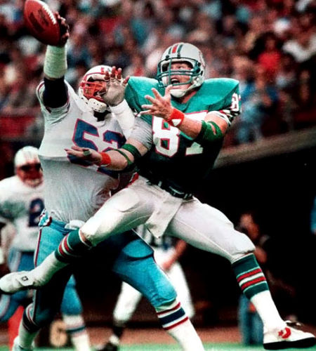 """""""TIPPED AWAY"""" 1983 NFL HALL OF FAME PHOTO OF THE YEAR.  Houston Oilers Robert Brazille tips a pass away from Miami Dolphins Dan Johnson."""