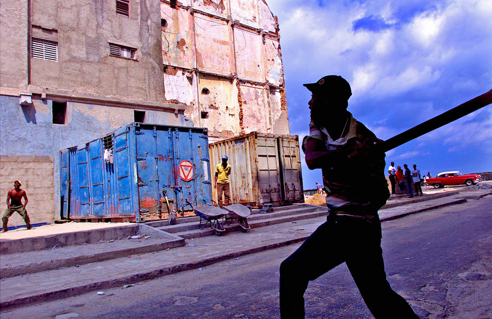 Baseball or stickball  is played  everywhere in Havana, Cuba.