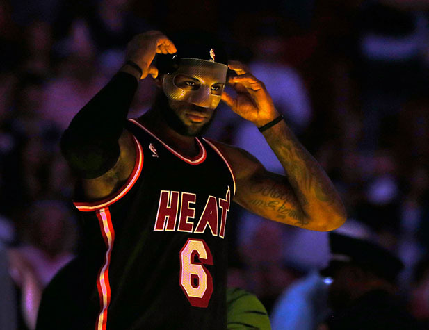 LeBron James adjusts his protective mask.