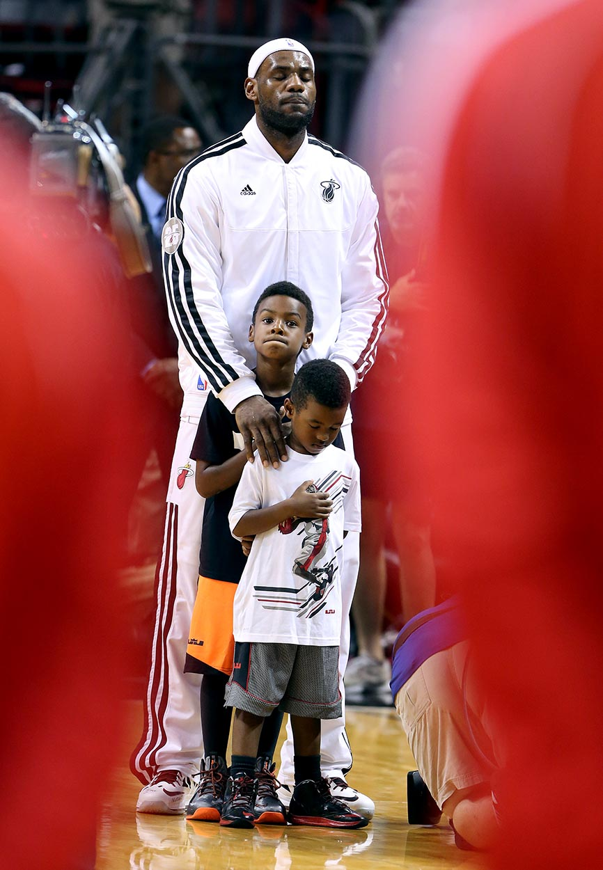 LeBron James stands with his children in memory of children shot at Sandy Hook elementary school.