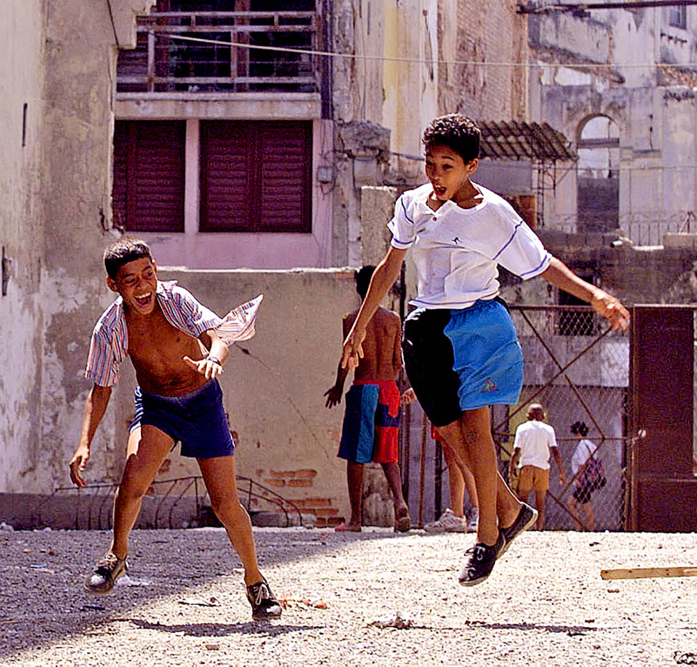 Kids celebrate a home run, Havana , Cuba