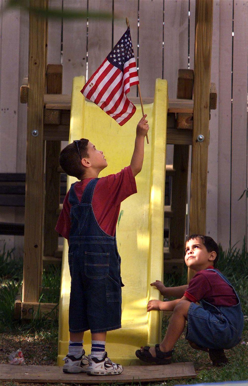 Elian Gonzalez holds an American flag