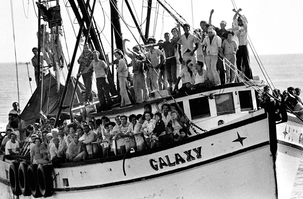 Cuban refugees arrive in an overcrowded vessel , Key West.