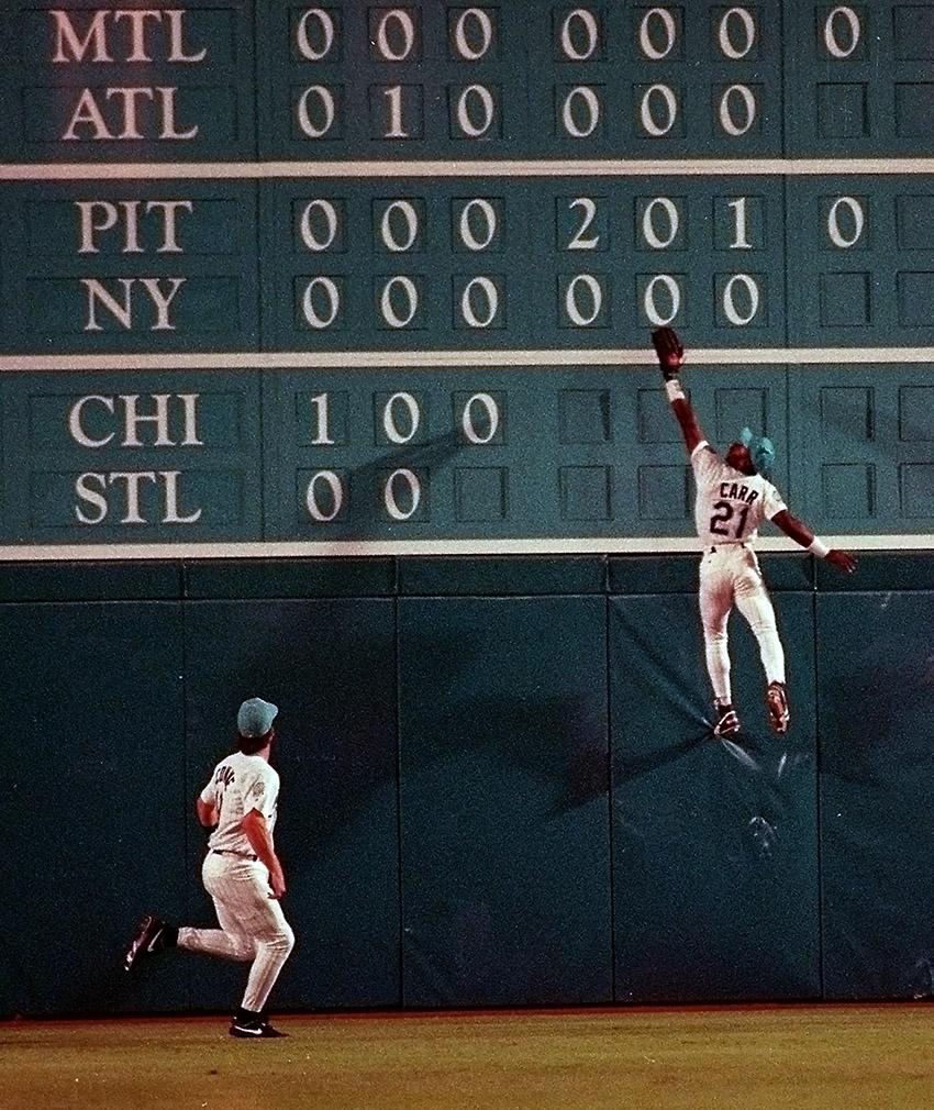 Chuckie Carr climbs the scoreboard wall.