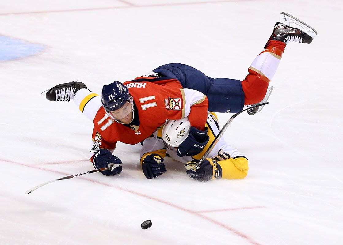 Panthers vs Predators:  battle for the puck.