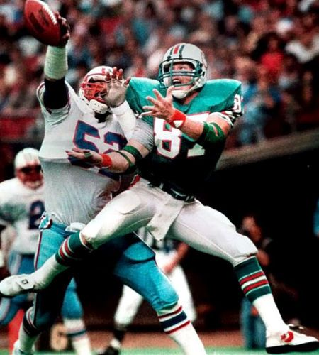 Houston Oilers Robert Brazille tips a pass away from Miami Dolphins Dan Johnson.