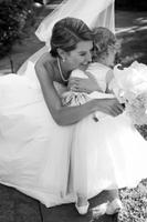 bridehugsflowergirlafterceremony.jpg
