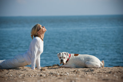 womananddogdoingyogaonbeach.jpg