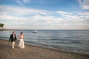newlywedswalkbeachatsunset.jpg