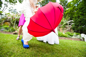 fashionablebridewithredumbrella.jpg
