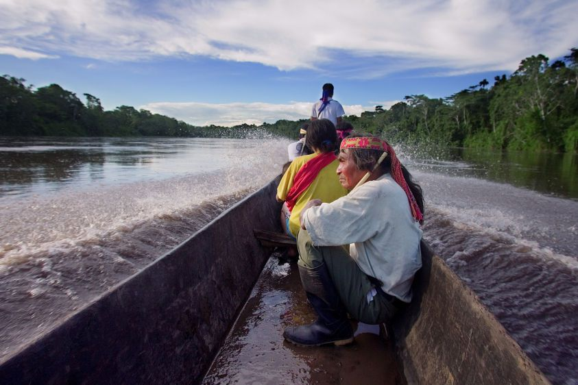 Traveling by canoe with the Achuar on the Pastaza River to the village of Sharamentza.