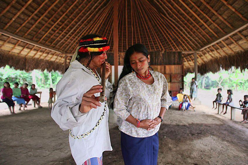 A traditional dance in the Achuar village of Sharamentza.