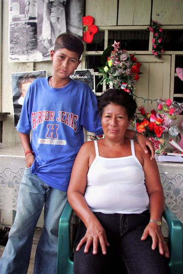 Dolores Morales with her fifteen-year-old son Jose who suffers from leukemia at their home in Sacha.