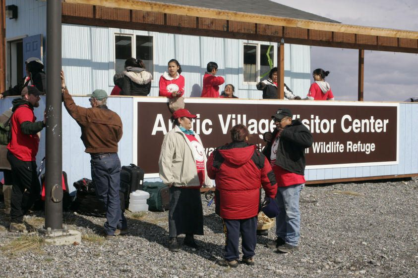 "Gwich'in people and supporters arrive at visitor center before staging of human banner to ""Save the Arctic""."
