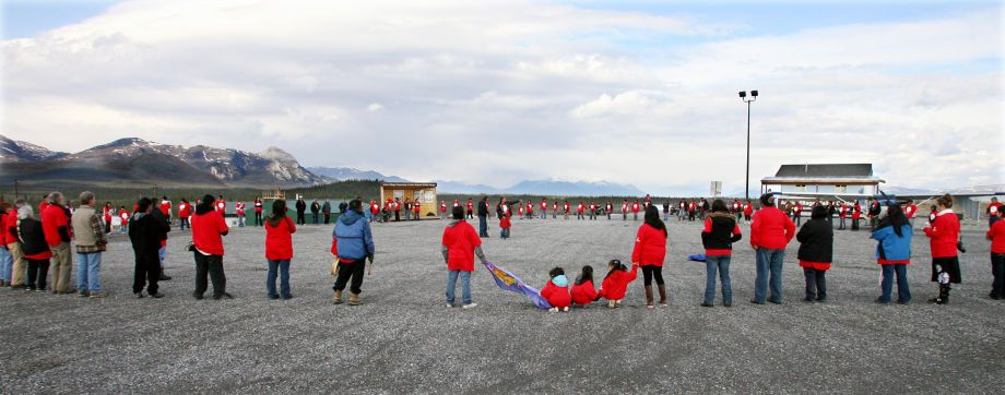 "Gwich'in people and supporters pray and reflect before staging of human banner to ""Save the Arctic""."