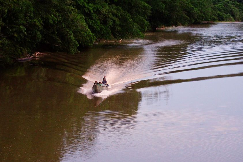 A canoe travels down the Bobonaza River through the Kichwa community of Sarayaku.