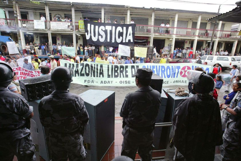 Ecuadorian Special Forces wear riot gear as they stand between demonstrators and the entrance to the courthouse in Lago Agrio at the start of the trial against Chevron (formerly Texaco).