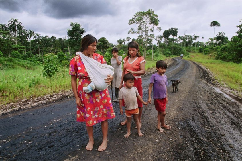 Maria Aguinda, of the Kichwa indigenous group, with her family on the oil-soaked Via Auca in the family's village of Rumipamba in 1993. Aguinda is the lead plaintiff in the class action lawsuit against Chevron (formerly Texaco) seeking a clean up of petr